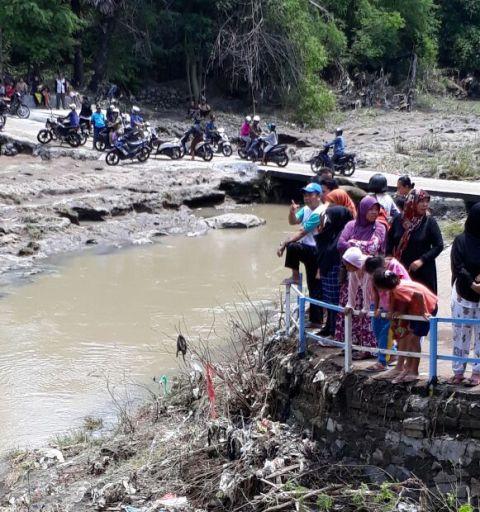 Sungai tempat korban jatuh dan terseret arus deras dan hilang.