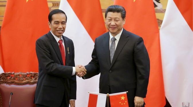 Indeks kepercayaan Indonesia masih tinggi, walau diguncang berbagai perisitiwa politik lokal.  Presiden Jokowi dan Presiden China Xi Jinping.
