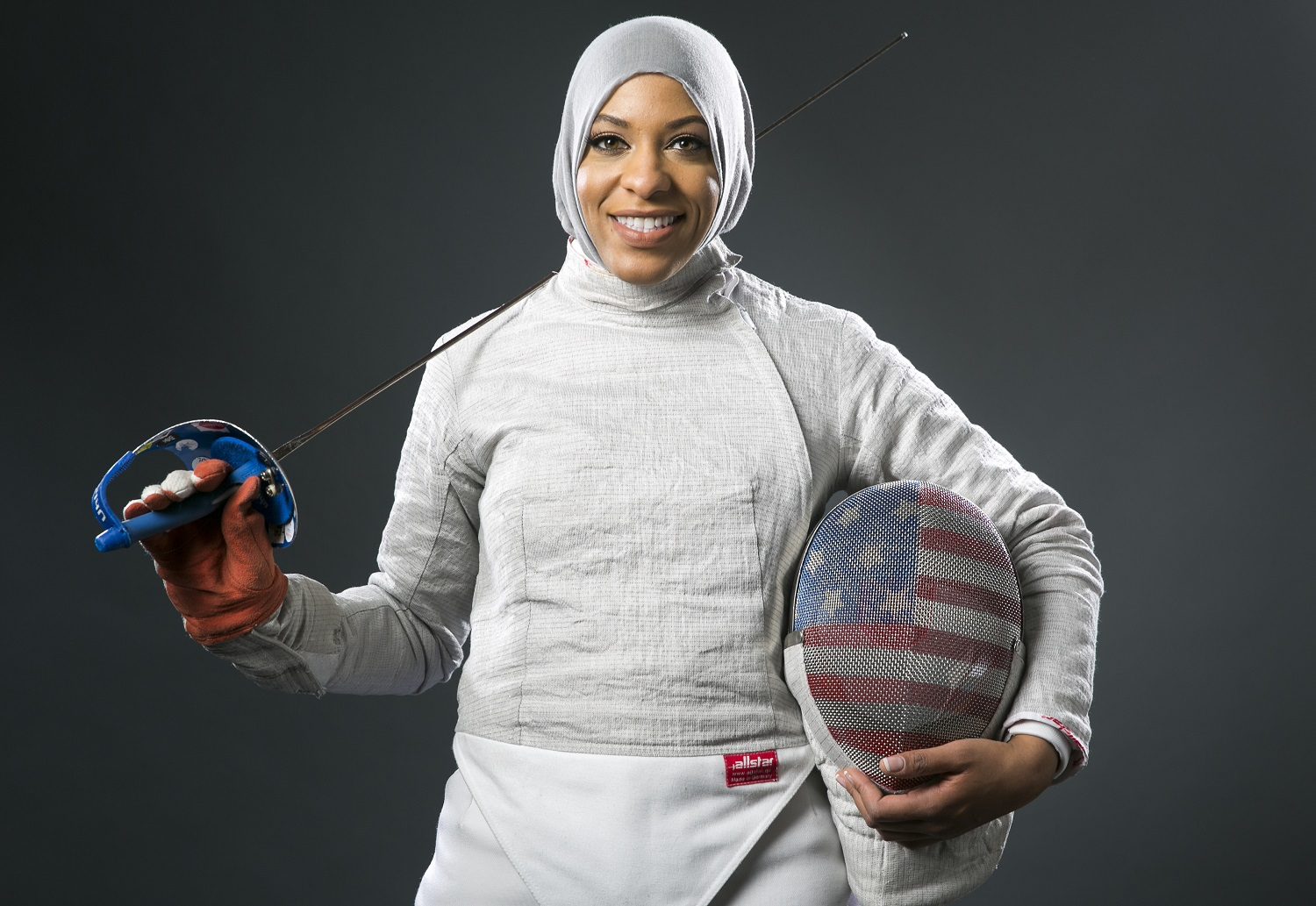 Fencer Ibtihaj Muhammad poses for photos at the 2016 Team USA Media Summit Wednesday, March 9, 2016, in Beverly Hills, Calif. (AP Photo/Damian Dovarganes)