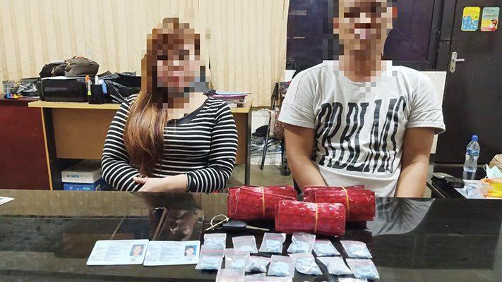Pasangan suami istri  diamankan petugas saat pesta narkoba di tempat hiburan di kota Pontianak. (foto:das)